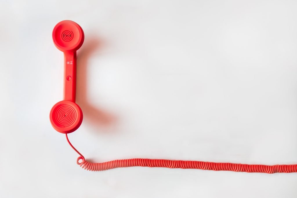 Red corded telephone vintage retro phone line