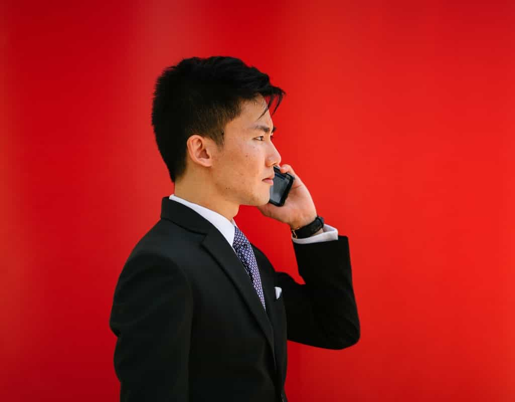 Asian man in a suit on the phone